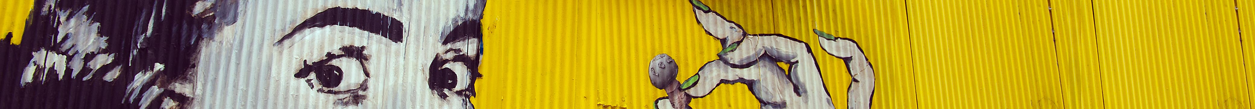 Woman, painted on yellow metal sheets in Valparaiso, Chile - Banner