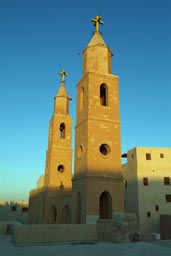 Saint Anthony monastery-church towers, Egypt, evening light.