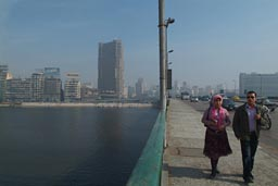 Cairo and smog, couple on bridge.