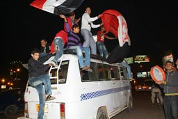Cairo 2010, CAN celebrations of football fans in streets, honking cars, bus.