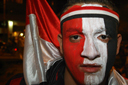 Egyptian boy face painted in Egyptian colours, CAN 2010 victory celebrations in Cairo.