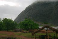 Northern Benin, green misty, basalt rock formation, hut