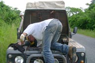 Land Rover, Ghana, hood open, me fixxing a loose hose.