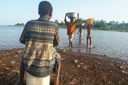 Children on lake Volta, Ghana fetch water