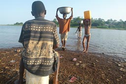 Carrying water in Africa, kids