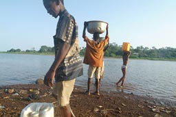 Prime duty in morning for African children, go get water from lake.