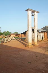 Church bell tower, school children, village Togo