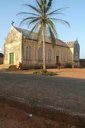 Church, Palm tree, road, two men. Danyi, Togo