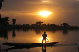 Niger River sunset and pirogue.