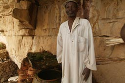 Elder Dogon shows me water source in Dogon escarpement.