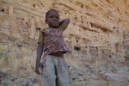 Mali, Tellem mud granaries in Bandiagara Escarpment, Dogon child in Irelli.