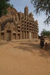 New Dogon village of Telly, mosque. Woman and child.