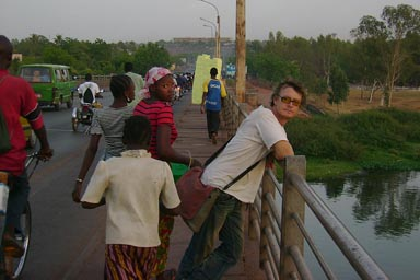 On the old bridge in Bamako, passers by, Niger river.