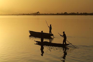 Golden sunset, 2 pirogues on Niger River.