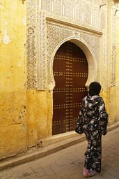 Fes, ornamented door, arabesque, young veiled woman