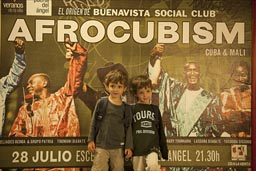 My twin boys in Madrid Metro in front of the Afrocubism bill board, I happen to know Toumani Diabate and Bassekou Kouyate from Mali too well.