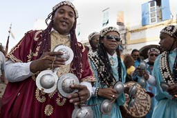 Silver castagnettes. smiling Gnawa.