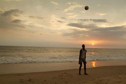 Footballer on Lumley beach, Aberdeen, Freetown, Sierra Leone, sunset.