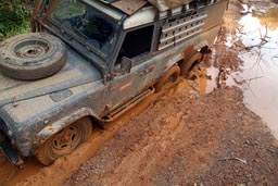 Liberia, 6x6 Land Rover Defender, stuck in mud hole, muddy roads.