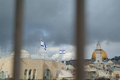 Israeli flags fly high, Rock of the dome.