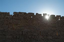 Sun behind Wall of Karak Castle, Jordan.