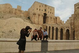 Citadel, Aleppo, 3 men being photographed by lady.