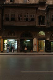 Night, street Aleppo, old wooden house, boy.