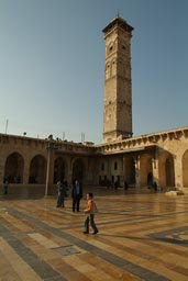 Great Mosque of Aleppo. Minaret and boy.