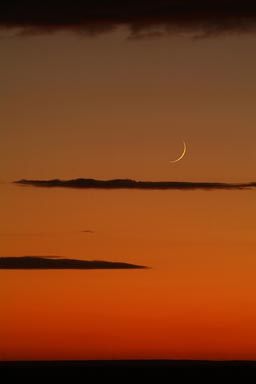 Orange skies, new moon, Syria.