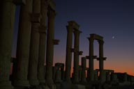 New moon over collonades in Palmyra at dusk.