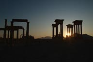 Sun through tetrapylon silhouette, Palmyra.