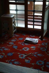 News paper on carpet, plastic stool window, of Sultan Ahmed mosque.