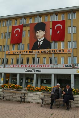 Kastamonu, two old turkish muslims in front of Ataturk posters and Turkish flags on end of Ramadan.