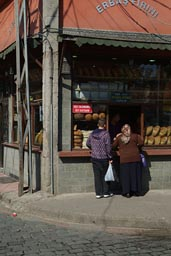 Woman buying bread at bakery. Trabzon, Turkey.