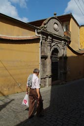 Me walking in front of yellow Ottoman building in Trabzon.