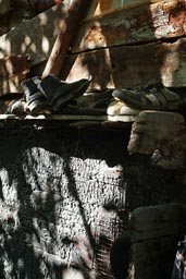 Shoes on shelf, wooden barn, farm, Camlikaya, Turkey.