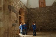Curious kids in school uniform come see me in Dsolishan church, Turkey.