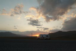 Mercedes 307D van, sun sets behind, road to Ararat, Turkey.