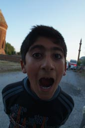 Child in Ahlat, teenager, shouts.