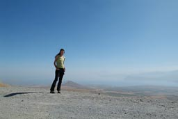 Christina on Nemrut crater rim eastern Turkey, Lake van below in a haze.