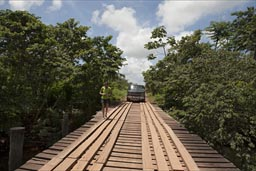 Wooden bridge in Belize on Dangriga road, van and Christina.
