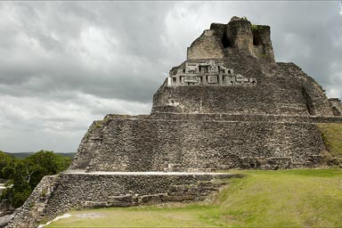 Sculptured frieze on structure in Xunantunich showing monumental masks, Belize.