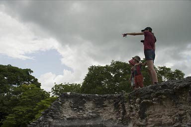 Some houler monkey is spotted. C. and boys are watching from pyramid, Xunantunich.