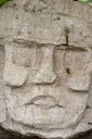 Maya Head/Face in stone, Caracol, Belize..