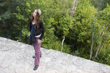 C. and red Todos Santos pants in Tikal on top of Temple 4, Maya Jungle below, Peten Guatemala.