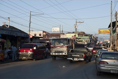 Morning traffic struggles through Rio Dulce/Fronteras town, Guatemala.