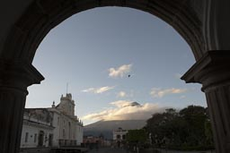 Volcan de Agua, Antigua. Guatemala. A bird flies, morning blue skies, the usual clouds.