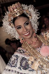 She is the queen Las Tablas 2012. Static smile, gold and crown and tembleques, pollera dress.