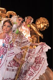 Queens on a queens cart, and golden statue in back. Las Tablas, Carnival..