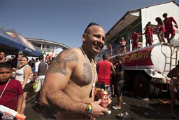 Tattoos and beers, carnival of Las Tablas, Panama.